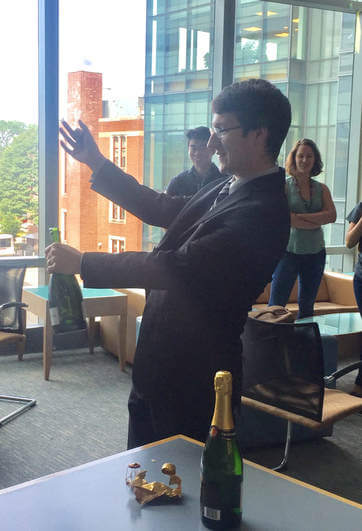 Scientist opens bottle of champagne